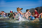 Ohio University students wade through cold water during the sixth-annual Polar Bear Plunge held at Lake Snowden in Albany, Ohio. The charity event held by the Ohio University Police Department and Phi Kappa Theta Fraternity raised money for Special Olympics Ohio, to raise money and awareness for individuals with intellectual disabilities.
