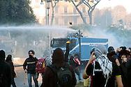 Roma  15 Ottobre 2011.Manifestazione contro la crisi e l'austerità.Scontri tra manifestanti e forze dell'ordine.Un mezzo della polizia con i cannoni ad acqua vieni assaltato dai manifestanti in pzza San Giovanni.