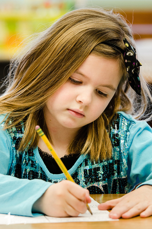 A young girl works in her class at Holy Cross Lutheran Church and School on Friday, Feb. 21, 2014, in Collinsville, Ill. LCMS Communications/Erik M. Lunsford