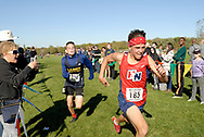 Two young men, athlete numbers 185 and 375, approach the finish line at a Windsor and Essex County Catholic Secondary Schools Athletic Association cross country championship race at Malden Park in Windsor, Ontario, Canada.