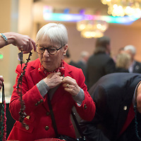 Judith Lavender, founder of the Early Childhood and Family Center at the University of New Mexico-Gallup collects a corn necklace to the entrance of the McKinley County-Gallup Day Gala Reception at the Eldorado Hotel in Santa Fe Thursday.