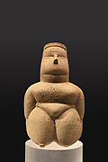 Seated figure with head ornament in limestone, Neolithic period, 5th millennium BC, from the Cabras Tomb 386 at Cuccuru s'Arriu, Sardinia, from the Museo Archeologico Nazionale, Cagliari, Sardinia, in the Idols exhibition, Sept 2018-Jan 2019, exploring 3-dimensional images of the human body created 4000–2000 BC, at the Fondazione Giancarlo Ligabue, Venice, Italy. Picture by Manuel Cohen