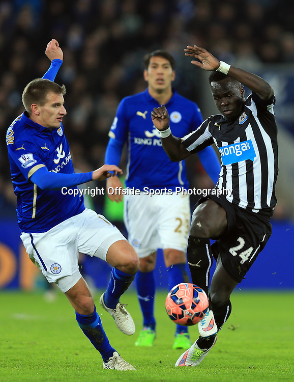 3 January 2015 - The FA Cup 3rd Round - Leicester City v Newcastle United - Marc Albrighton of Leicester City tangles with Cheik Ismael Tiote of Newcastle United - Photo: Marc Atkins / Offside.