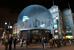 © Licensed to London News Pictures. FILE PICTURE 18/11/2013. London, UK. A 30ft snow globe covers the Eros statue to protect the famous Grade I listed statue from vandalism during the Christmas party season at Picadilly Circus.Photo credit : Peter Kollanyi/LNP