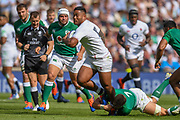 England player Manu Tuilagi breaks through an Irish tackle in the first half during the England vs Ireland warm up fixture at Twickenham, Richmond, United Kingdom on 24 August 2019.