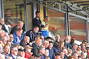 Notts County manager Harry Kewell has to stand at the back of the stand after being sent off by the referee during the EFL Sky Bet League 2 match between Exeter City and Notts County at St James' Park, Exeter, England on 8 September 2018.