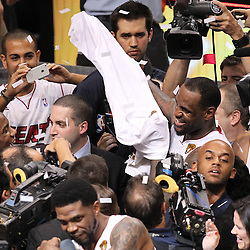 Jun 21, 2012; Miami, FL, USA; Miami Heat small forward LeBron James (6) celebrates after winning the 2012 NBA championship at the American Airlines Arena. Miami won 121-106. Mandatory Credit: Derick E. Hingle-US PRESSWIRE