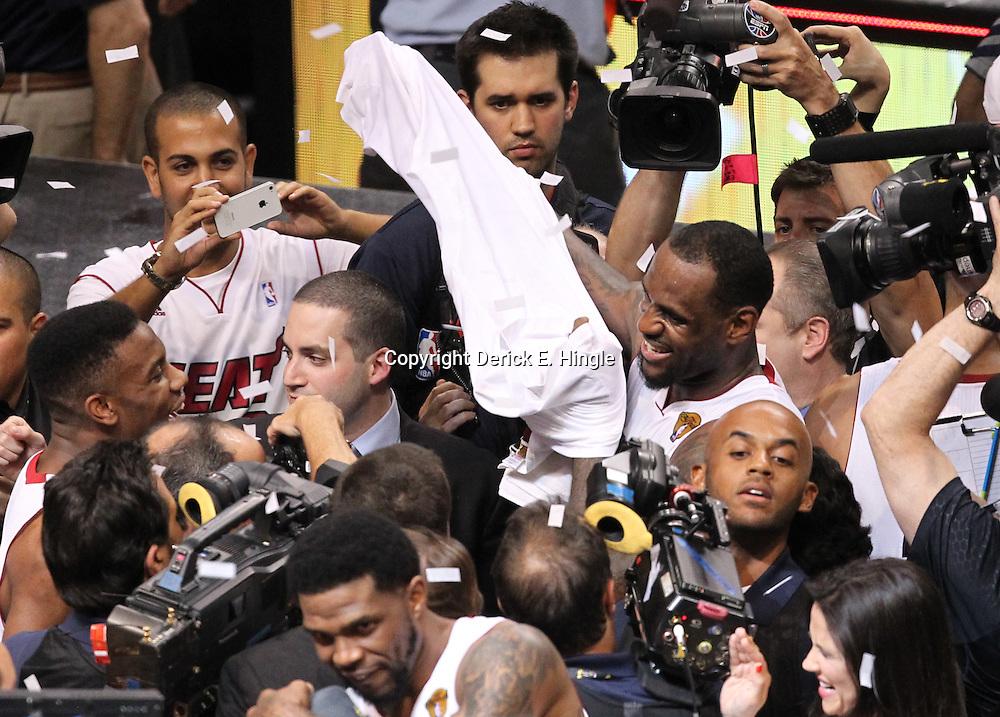 Jun 21, 2012; Miami, FL, USA; Miami Heat small forward LeBron James (6) celebrates after winning the 2012 NBA championship at the American Airlines Arena. Miami won 121-106. Mandatory Credit: Derick E. Hingle-US PRESSWIRE