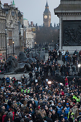 © Licensed to London News Pictures.23/03/2017.London, UK.  People gather in Trafalgar Square for a vigil to remember the victims of Wednesday's terror attack.  A lone terrorist killed 4 people and injured several more, in an attack using a car and a knife. The attacker managed to gain entry to the grounds of the Houses of Parliament, killing one police officer.Photo credit: Peter Macdiarmid/LNP