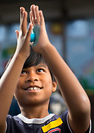 Dola Nie Mah, 10, with his new rubber ball made with glue and other simple ingredients.<br /> <br /> Fifth graders at Irving Park Elementary create bouncy balls during as science experiment at the school Friday, November 17, 2017.<br /> <br /> Photographed, Friday, November 17, 2017, in Greensboro, N.C. JERRY WOLFORD and SCOTT MUTHERSBAUGH / Perfecta Visuals