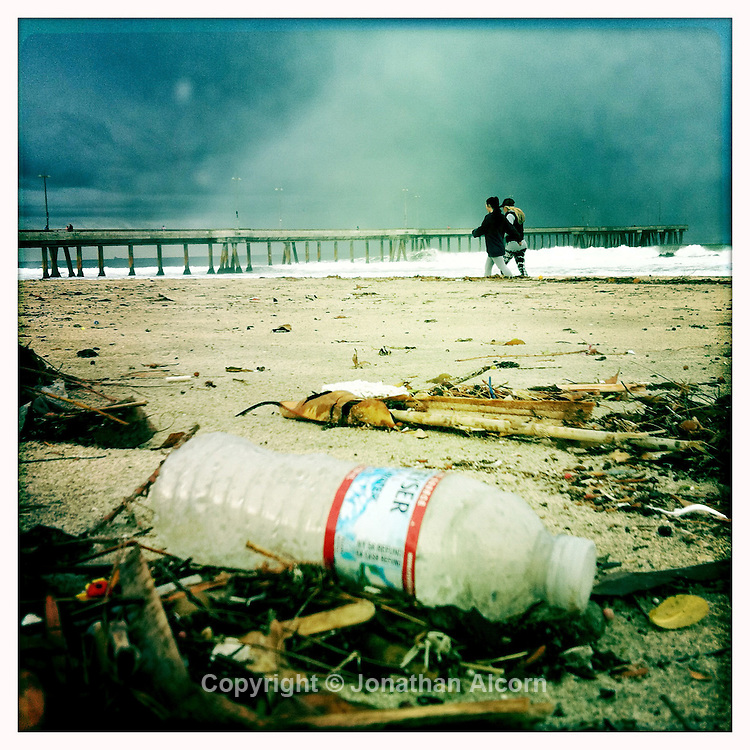 Pollution including a plastic water bottle washed ashore after a rain storm in Southern California.