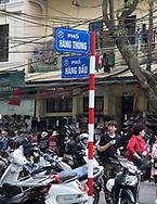 Shoppers and motorcycles on a busy street in the Old Quarter, Hanoi, Vietnam, Southeast Asia