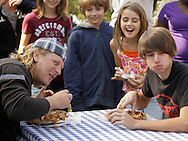 New Hampton, New York - Spectators and contestants enjoy the pie eating contest during the celebration of 100 years in business at Soons Orchards and Farm Market on Oct. 11, 2010.