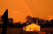 A double rainbow at sunset in Amherst, Ohio, USA.