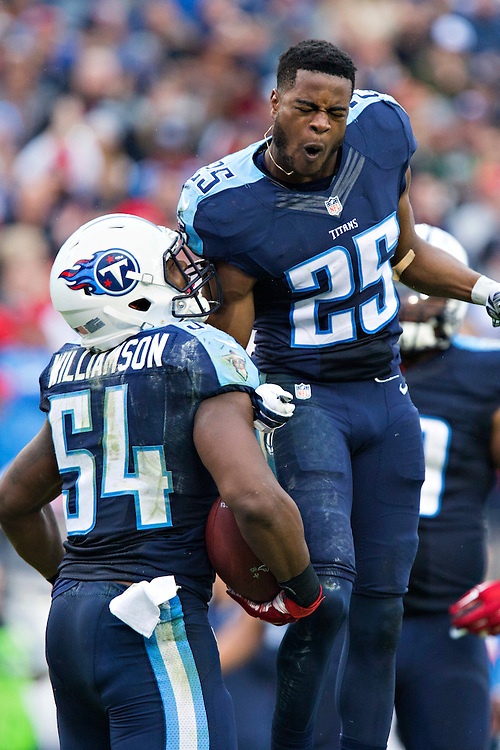 NASHVILLE, TN - OCTOBER 25:  Blidi Wreh-Wilson #25 celebrates with Avery Williamson #54 of the Tennessee Titans after a interception during a game against the Atlanta Falcons at Nissan Stadium on October 25, 2015 in Nashville, Tennessee.  The Falcons defeated the Titans 10-7.  (Photo by Wesley Hitt/Getty Images) *** Local Caption *** Blidi Wreh-Wilson; Avery Williamson