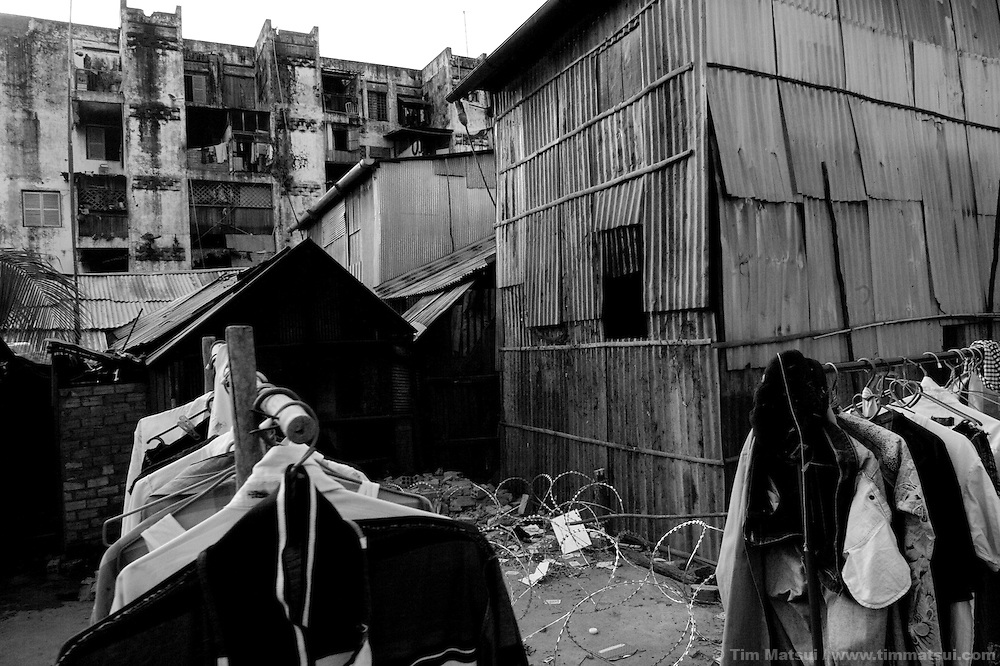 """Scenes from a slum where the agency """"Acting for Women in Distressing Situations"""" (AFESIP) conducts outreach and provides services in Phnom Penh, Cambodia. The permanent structure, a decaying four story building known simply as 'The Building', was built in the 1960's as transitional housing and now hosts a shantytown where many of the city's poor live, including many prostitutes, and is believed to have the highest rate of HIV infection in the city. AFESIP hands out free condoms, instructs prostitutes on HIV prevention, and conducts outreach in case the prostitutes need medical services, choose to leave their profession, or can report on cases of sex trafficking. AFESIP offers housing, education, training, and counseling for women who are victims of sex trafficking, worked as prostitutes, or are escaping domestic violence. Founded by Somaly Mam, who herself was once a prostitute and victim of trafficking and domestic abuse, AFESIP has three facilities in Cambodia and works with other NGO's to provide long term care for the women."""