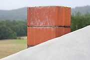 a red brick chimney against a mountain view background