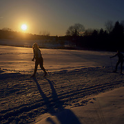 Cross country skiers at sunset, Carlisle, Massachusetts.