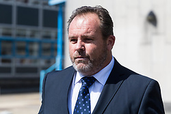 Former BA pilot Julian Monaghan, 49, leaves Croydon Magistrates Court where he faces charges of being 4 times over the drink-fly limit after being hauled off a flight by armed police before take-off for Mauritius. Croydon, June 06 2018.
