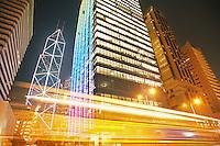 China Hong Kong low angle view of illuminated skyscrapers (long exposure)