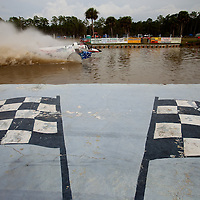 NAPLES, FL -- March 6, 2011 -- Buggies take off at the start of a heat during the Swamp Buggy Races at the Florida Sports Park in Naples, Fla., on Sunday, March 6, 2011.  The races originated in the 1940's by bored hunters and draws thousands of fans three times a year to take in the buggies and jeep compete in the swamp. (Chip Litherland for ESPN the Magazine)