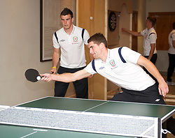 CARDIFF, WALES - Tuesday, September 4, 2012: Wales' Sam Vokes and Gareth Bale during a players' table tennis tournament at the St. David's Hotel ahead of the Brazil 2014 FIFA World Cup Qualifying Group A match against Belgium. (Pic by David Rawcliffe/Propaganda)