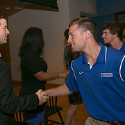 April 25, 2014, Baltimore, MD:<br /> The 2014 class of inductees shake hands with current student athletes during the Goucher Athletics 2014 Hall of Fame induction ceremony at Goucher College in Baltimore, Maryland Friday, April 25, 2014.<br /> (Photo by Billie Weiss)
