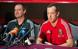 KUALA LUMPUR, MALAYSIA - Saturday, July 16, 2011: Liverpool's assistant manager Steve Clarke and new signing Charlie Adam during a press conferene in place of the absent Kenny Dalglish at the National Stadium Bukit Jalil in Kuala Lumpur on day six of the club's Asia Tour. (Photo by David Rawcliffe/Propaganda)