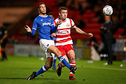 Portsmouth defender Christian Burgess (6) tackles Doncaster Rovers defender Harry Toffolo (18), on loan from Norwich City,  during the EFL Sky Bet League 1 match between Doncaster Rovers and Portsmouth at the Keepmoat Stadium, Doncaster, England on 17 October 2017. Photo by Simon Davies.