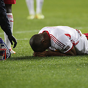 Jamison Olave, New York Red Bulls lies on the ground after clashing heads with Jackson, Toronto FC, during the New York Red Bulls Vs Toronto FC, Major League Soccer regular season match at Red Bull Arena, Harrison, New Jersey. USA. 11th October 2014. Photo Tim Clayton