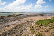 Coastal landscape looking inland at low tide, Holy Island, Lindisfarne, Northumberland, England, UK