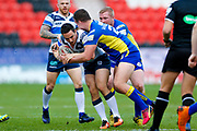 Featherstone Rovers scrum half Tom Holmes (19) is stopped during the Challenge Cup 2018 match between Doncaster and Featherstone Rovers at the Keepmoat Stadium, Doncaster, England on 22 April 2018. Picture by Simon Davies.