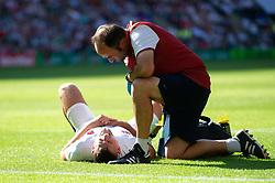 Jonny May of England is treated for an injury - Mandatory byline: Patrick Khachfe/JMP - 07966 386802 - 24/08/2019 - RUGBY UNION - Twickenham Stadium - London, England - England v Ireland - Quilter International