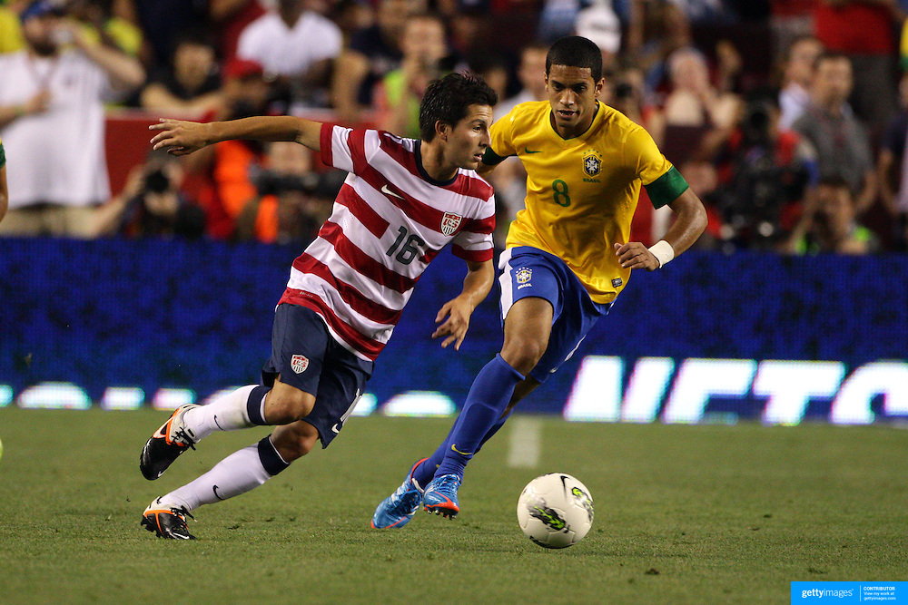 Jose Torres, USA, goes past Romula, Brazil, during the USA V Brazil International friendly soccer match at FedEx Field, Washington DC, USA. 30th May 2012. Photo Tim Clayton