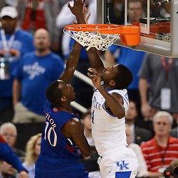 Apr 2, 2012; New Orleans, LA, USA; Kansas Jayhawks guard Tyshawn Taylor (10) has his shot blocked by Kentucky Wildcats forward Michael Kidd-Gilchrist (14) during the second half in the finals of the 2012 NCAA men's basketball Final Four at the Mercedes-Benz Superdome. Mandatory Credit: Derick E. Hingle-US PRESSWIRE