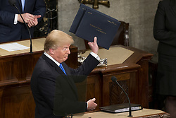 January 30, 2018 - Washington, District Of Columbia, USA - United States President DONALD J. TRUMP holds up copies of the State Of The Union Address prior to delivering the speech to a joint session of Congress at the United States Capitol in Washington, D.C. on January 30, 2018. (Credit Image: © Alex Edelman via ZUMA Wire)