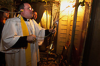 "Fr. Hall blesses the back door of a residence and banishes any entities, ""not of God's creation,"" to go back to where they came from. He prays that the spirits, which have supposedly turned on TV's, scratched the male owner, given the children nightmares and appeared in photos, move away and leave the family alone."