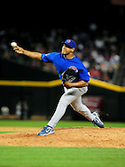 Apr. 29 2011; Phoenix, AZ, USA; Chicago Cubs pitcher Carlos Marmol (49) pitches during the ninth inning against the Arizona Diamondbacks at Chase Field. The Cubs defeated the Diamondbacks 4-2. Mandatory Credit: Jennifer Stewart-US PRESSWIRE..