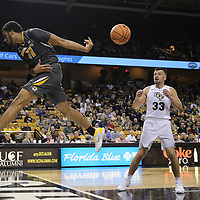ORLANDO, FL - NOVEMBER 30: Jontay Porter #11 of the Missouri Tigers makes a leaping save to keep the ball in play as Djordjije Mumin #33 of the UCF Knights looks on during a NCAA basketball game at the CFE Arena on November 30, 2017 in Orlando, Florida. (Photo by Alex Menendez/Getty Images) *** Local Caption *** Jontay Porter; Djordjije Mumin