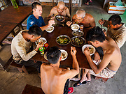 "15 FEBRUARY 2019 - SIHANOUKVILLE, CAMBODIA: Chinese construction workers eat lunch at the dining hall in the housing complex at which they live. There are about 80 Chinese casinos and resort hotels open in Sihanoukville and dozens more under construction. The casinos are changing the city, once a sleepy port on Southeast Asia's ""backpacker trail"" into a booming city. The change is coming with a cost though. Many Cambodian residents of Sihanoukville  have lost their homes to make way for the casinos and the jobs are going to Chinese workers, brought in to build casinos and work in the casinos.      PHOTO BY JACK KURTZ"