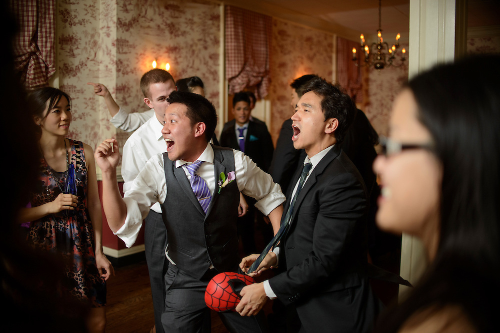 Photo by Matt Roth.Assignment ID: 30140754A..Wedding attendees dance during Evelyn Hsieh and Michael Wong's reception at the the Mount Vernon Inn, in Mount Vernon, Virginia on Saturday, April 06, 2013.