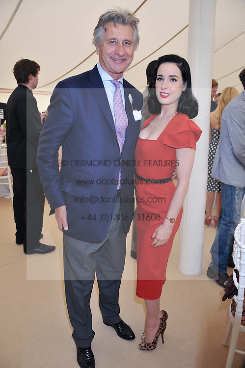 DITA VON TEESE and ARNAUD BAMBERGER at the Cartier Queen's Cup Polo Final, Guards Polo Club, Windsor Great Park, Berkshire, on 17th June 2012.