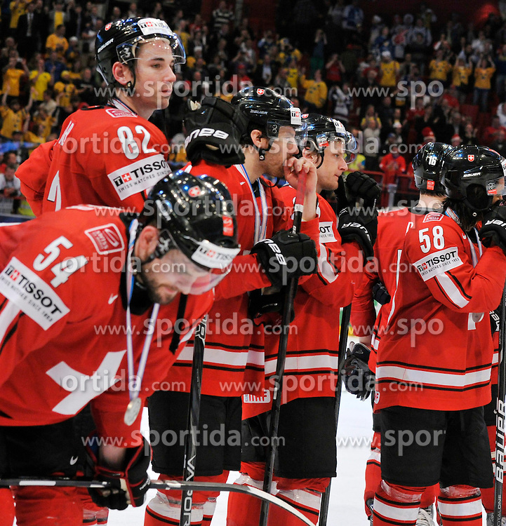 19.05.2013, Globe Arena, Stockholm, SWE, IIHF, Eishockey WM, Schweden vs Schweiz, im Bild Switzerland Schweiz disappointed dejected // during the IIHF Icehockey World Championship Game between Sweden and Switzerland at the Ericsson Globe, Stockholm, Sweden on 2013/05/19. EXPA Pictures © 2013, PhotoCredit: EXPA/ PicAgency Skycam/ Simone Syversson..***** ATTENTION - OUT OF SWE *****
