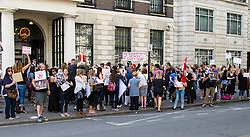 London, June 26th 2015. Scores of animal lovers descend on the Chinese embassy to protest against the Yulin Dog Meat Festival where thousands of dogs, often killed using extremely cruel methods, are eaten. According to one anti-cruelty activist, the Yulin festival is only 10 years old and is a possible backlash against the anti-dog meat crusade from the west.