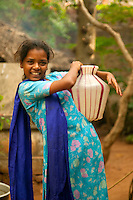 young woman with water bucket, Kerala, India