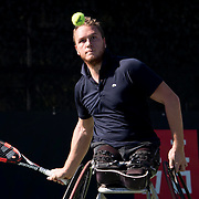 Nico Piefer returns a serve during a wheelchair tennis match at marguerite tennis center in Mission Viejo, Calif., on Thursday November 3, 2016. (© Kurt Stoffer 2016/Sports Shooter Academy)
