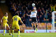Port Vale midfielder Sam Foley (11) heads the ball on  during the EFL Sky Bet League 1 match between Port Vale and AFC Wimbledon at Vale Park, Burslem, England on 1 April 2017. Photo by Simon Davies.