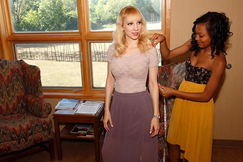 Model Nadia Yaroshenko of Huber Heights (left) gets measured by designer Jamila Jones of Dayton during a Dayton Fashion Week meeting at SunWatch Indian Village/Archaeological Park in Dayton, Saturday, July 21, 2012.
