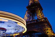 Carousel and the Eiffel tower, Paris, Ile-de-france, France