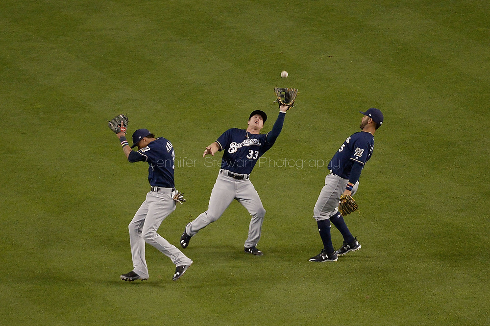 PHOENIX, AZ - JUNE 09:  Brett Phillips #33 of the Milwaukee Brewers catches a fly ball between Orlando Arcia #3 and Jonathan Villar #5 in the fourth inning of the MLB game against the Arizona Diamondbacks at Chase Field on June 9, 2017 in Phoenix, Arizona.  (Photo by Jennifer Stewart/Getty Images) *** Local Caption *** Brett Phillips; Orlando Arcia; Jonathan Villar